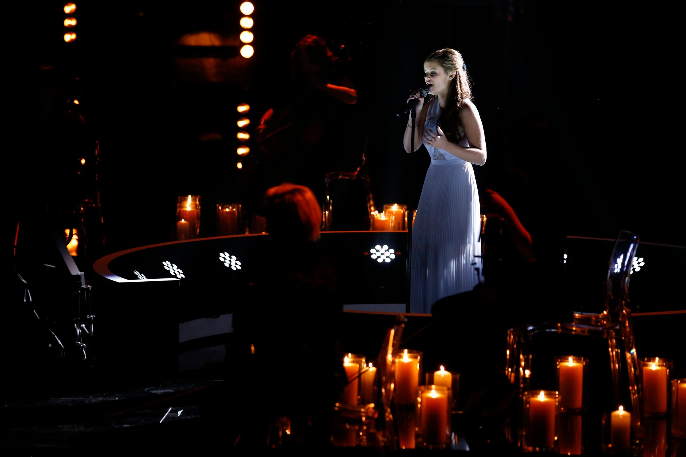 """Then it was on to the semifinals, where Jacquie, clad in an evening gown and shimmering in candlelight, gave a dramatic and powerful take on Sarah McLachlan's """"Angel,"""" punching her ticket to the finals."""