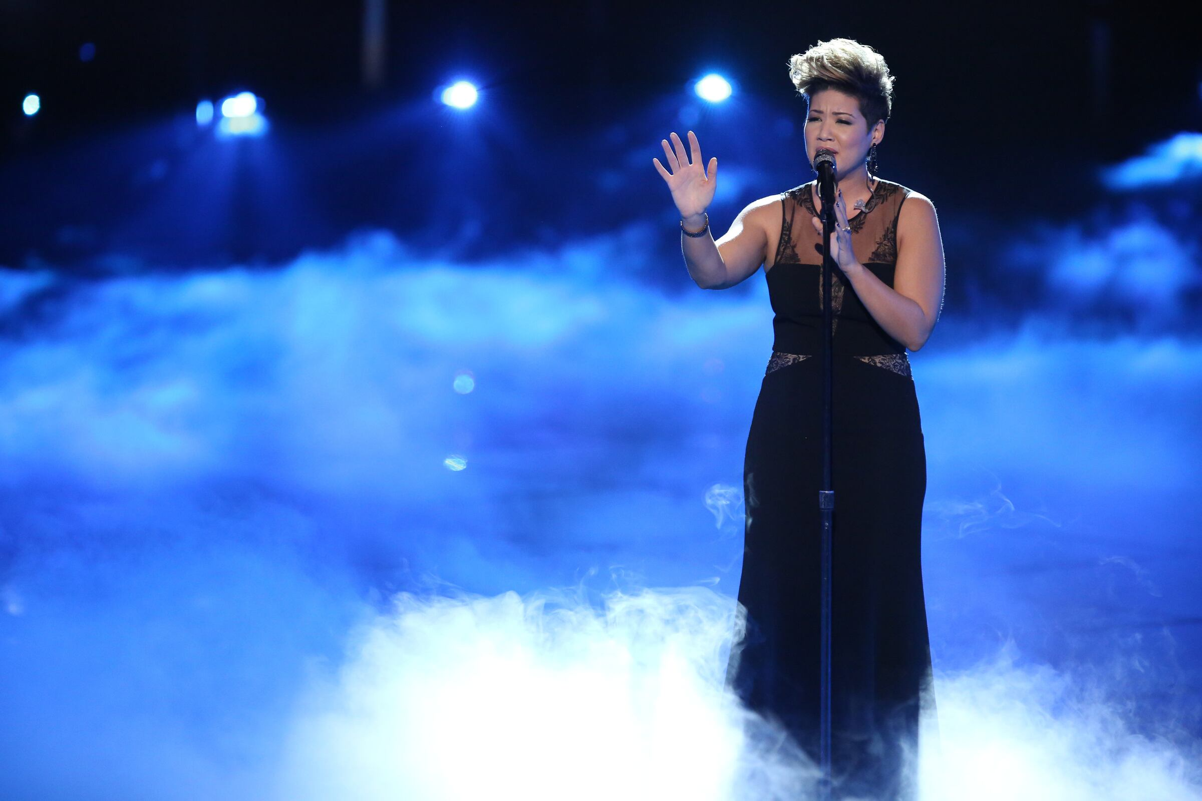 """Then it was on to her solo performance. Surrounded by stage smoke, Tessanne sank her teeth into Simon and Garfunkel's classic """"Bridge Over Troubled Water."""" It was a dramatic performance that easily put her into the finals."""