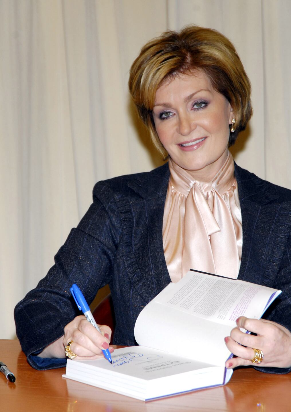 "Sharon Osbourne Signs Her New Autobiography ""Sharon Osbourne Extreme"" - October 25, 2006"